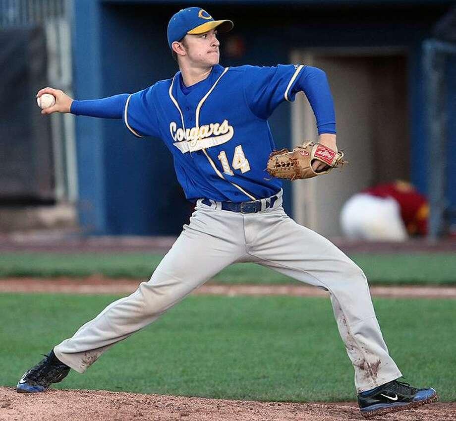 H-K's Jake DeCarli slides home as St. Joseph catcher Joe Burns loses track of the ball. H-K won, 15-6. / a