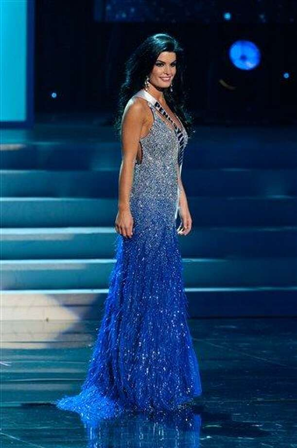 In this photo provided by the Miss Universe Organization, Miss Pennsylvania Sheena Monnin competes during the 2012 Miss USA Presentation Show on Wednesday in Las Vegas. Monnin resigned her crown claiming the contest is rigged, but according to organizers the beauty queen was upset over the decision to allow transgender contestants to enter. A posting on Monnin's Facebook page claims another contestant learned the names of the top 5 finishers on Sunday morning, hours before the show was broadcast. Associated Press Photo: AP / Miss Universe Organization