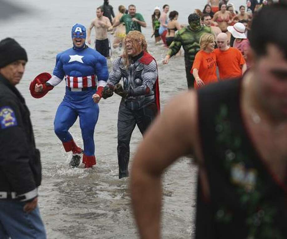 "Dispatch Staff Photo by JOHN HAEGER <a href=""http://twitter.com/oneidaphoto"">twitter.com/oneidaphoto</a>Participants race to the shore after taking a plunge into Oneida Lake to raise funds for the Special Olympics New York during the annual Polar Plunge on Sunday Dec. 2, 2012 at Oneida Shores in Brewerton."