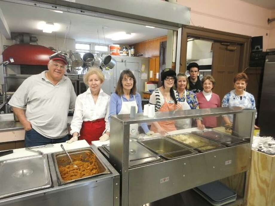 JASON SIEDZIK/ Register Citizen Volunteers dished up Easter lunch to about 70 patrons on Sunday. Pictured: Stanley Dziedzic, Sandy Heintz, Laurie Chipega, Marissa Dziedzic, Laurie Szabo, Chris Dziedzic, Pat Switzer and Jeannette Richards.