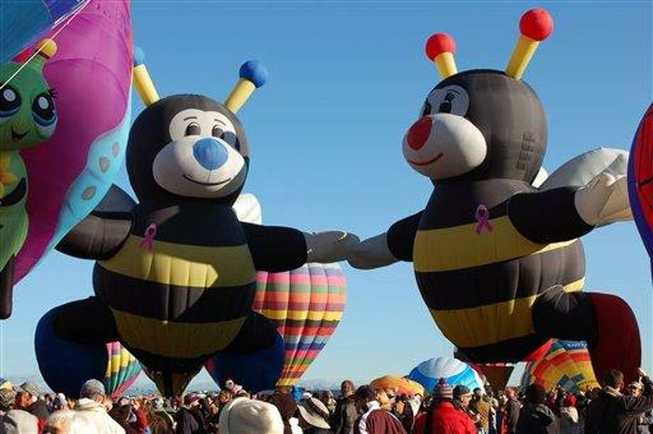 """""""Joey Little Bee"""" and """"Lilly Little Bee"""" hot air balloons are shown at the Albuquerque International Balloon Fiesta. ASSOCIATED PRESS photo Photo: AP / AP"""