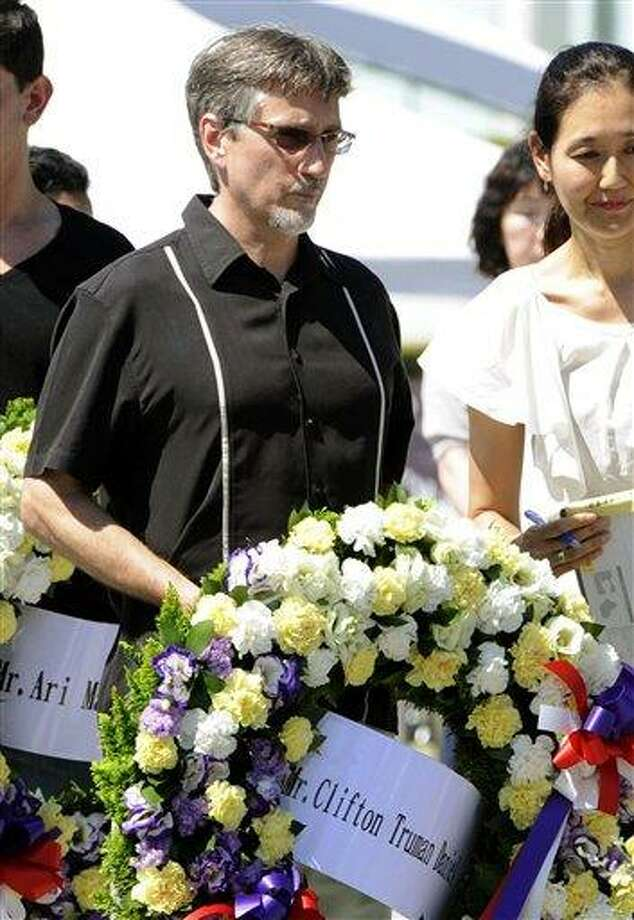 Clifton Truman Daniel, a grandson of former U.S. President Harry Truman, prepares for a wreath-laying ceremony at the Hiroshima Peace Memorial Park in Hiroshima, Japan, Saturday. Daniel, whose first visit to Japan was sponsored by a Japanese peace group, paid respect Saturday to the 140,000 people killed by the Aug. 6, 1945, bombing authorized by his grandfather.  Associated Press Photo: AP / Kyodo News