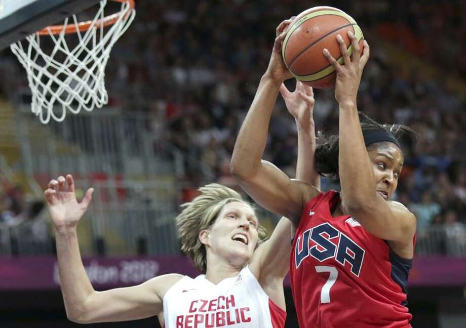 USA's Maya Moore, right, hauls down a rebound against Czech Republic's Jana Vesela during a women's basketball game at the 2012 Summer Olympics, Friday, Aug. 3, 2012, in London. (AP Photo/Charles Krupa) Photo: AP / AP2012
