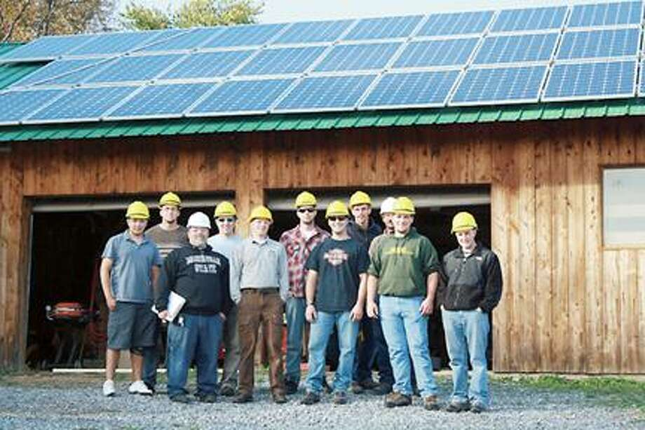 Photos Courtesy Jan Myers, project manager of Solarize Madison Morrisville State College faculty, staff and students and a representative from Arista Power stand in front of the completed solar photovoltaic system.