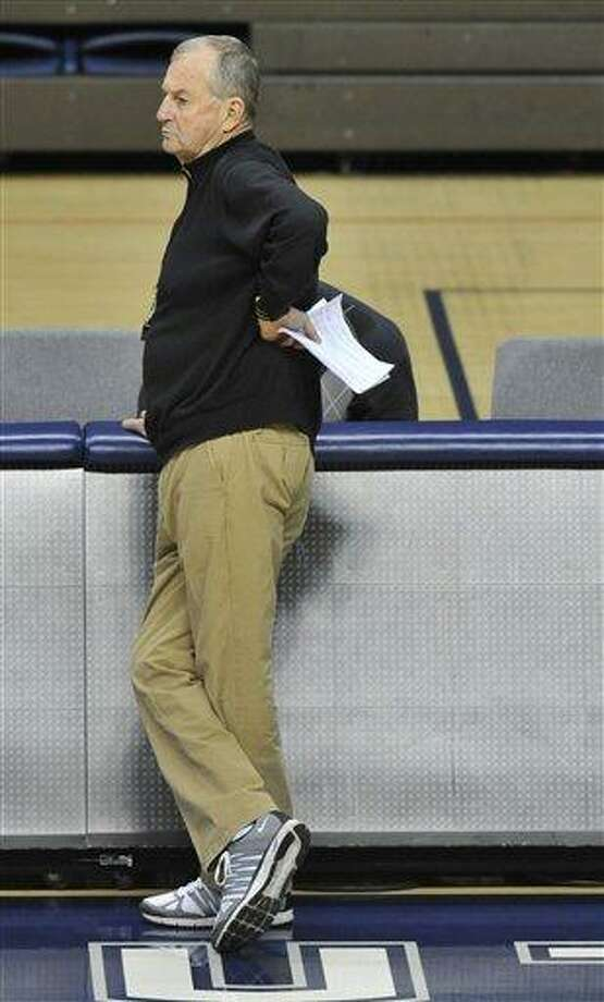 FILE - In this March 2, 2012, file photo, Connecticut men's basketball coach Jim Calhoun watches players during practice after his return from back surgery, in Storrs, Conn. Calhoun fractured a hip in a bicycle accident Saturday, Aug. 4, 2012, hours before he was supposed to coach a group of his former players in a charity game. (AP Photo/Jessica Hill, File) Photo: AP / FR125654 AP