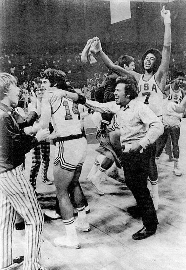 Associated Press file photo Ansonia native Greg Stamos (in background, second from left) had a front-row seat to one of the biggest controversies in Olympic history, when the U.S. men's basketball team thought it had beaten the Soviet Union for the gold medal in 1972. Game officials twice ruled the game wasn't over, and the Russians eventually won the game and the gold, handing the U.S. team its first loss in 63 Olympic basketball games.