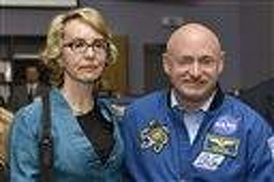 Former U.S. Congresswoman Gabrielle Giffords, left, and her husband Mark Kelly, right, NASA astronaut and commander of mission STS-134, pose for a picture at the Alpha Magnetic Spectrometer (AMS) Payload Operations and Command Center (POCC) at the European Organization for Nuclear Research (CERN) in Meyrin near Geneva, Switzerland. Associated Press Photo: AP / KEYSTONE