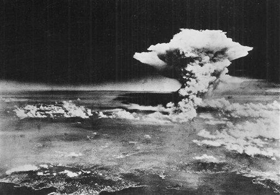 In this Aug. 6, 1945, file photo released by the U.S. Army, a mushroom cloud billows about one hour after an atomic bomb was detonated above Hiroshima, western Japan. Hiroshima will mark the 67th anniversary of the atomic bombing on Aug. 6, 2012. Clifton Truman Daniel, a grandson of former U.S. President Harry Truman, who ordered the atomic bombings of Japan during World War II, is in Hiroshima to attend a memorial service for the victims.  (AP Photo/U.S. Army via Hiroshima Peace Memorial Museum, HO, File) NO SALES, CREDIT MANDATORY Photo: AP / US Army via Hiroshima Peace Memorial Museum