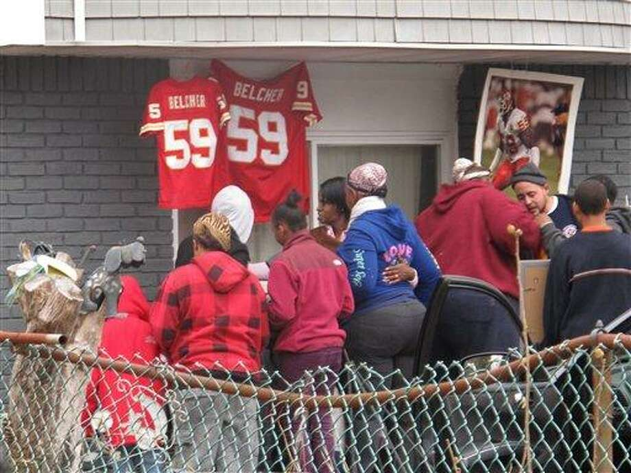 Friends and relatives of Kansas City Chiefs linebacker Jovan Belcher grieve outside the player's home on Dec. 1, 2012, in West Babylon, N.Y. Police said the Long Island native shot and killed his girlfriend before taking his own life on Saturday in Kansas City. (AP Photo/Frank Eltman) Photo: ASSOCIATED PRESS / AP2012