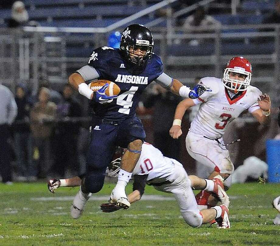 Ansonia-- Ansonia Vs Wolcott football game action at Nolan Field in Ansonia. Photo--Peter Casolino/New Haven Register.