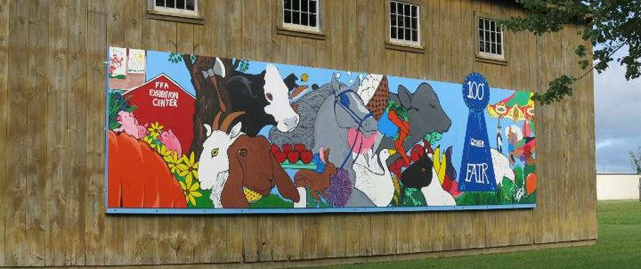 MICHELLE MERLIN/Register Citizen Candace Breakell painted a mural to honor the Goshen Fair's 100th anniversary.
