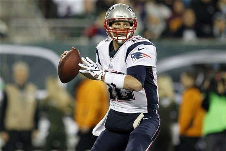 New England Patriots' Tom Brady (12) looks to pass during the first half of an NFL football game against the New York Jets Thursday, Nov. 22, 2012 in East Rutherford, N.J. (AP Photo/Julio Cortez) Photo: AP / AP