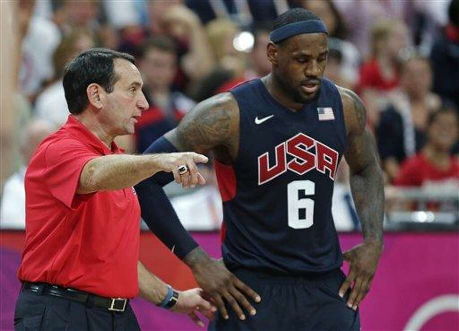 USA coach Mike Krzyzewski talks with LeBron James during a men's basketball game against Lithuania at the 2012 Summer Olympics, Saturday, Aug. 4, 2012, in London. (AP Photo/Charles Krupa) Photo: AP / AP