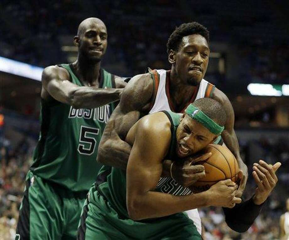 Boston Celtics' Kevin Garnett (5) watches as Paul Pierce and Larry Sanders battle for a loose ball during the second half of an NBA basketball game Saturday, Dec. 1, 2012, in Milwaukee. The Bucks won 91-88. (AP Photo/Morry Gash) Photo: AP / AP