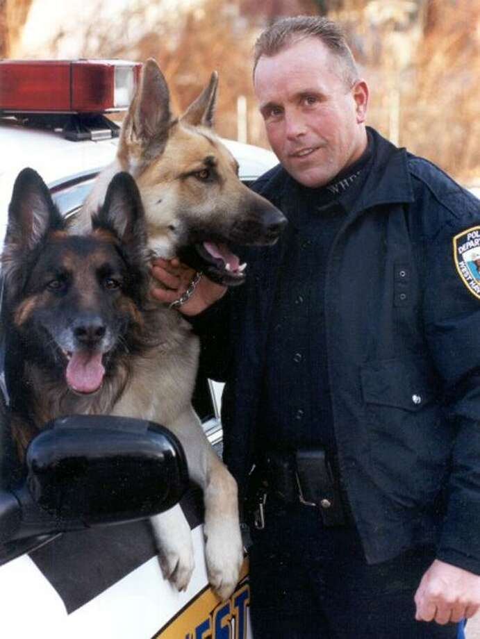 From left, K-9 Jake, K-9 Jo and Detective Sires.