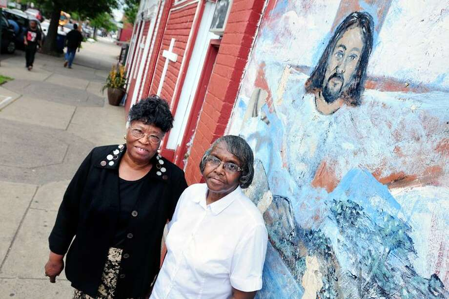 Pastors Julia McCarter (left) of the Deliverance Temple Church and Bernice Peterson (right) of Glorified Deliverance Center Church are photographed in front of the Deliverance Temple Church on Congress Ave. in New Haven on 5/30/2012.Photo by Arnold Gold/New Haven Register  AG0451B