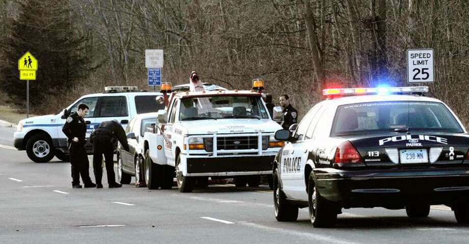 The Middletown Press  2.7.12  A Middletown Police cruiser blocks the entrance to Middletown High School as police reconstruct an accident involving two Middletown High School students on LaRosa Lane in Middletown. Motorists trying to enter LaRosa Lane were directed to use Mile Lane. / TheMiddletownPress