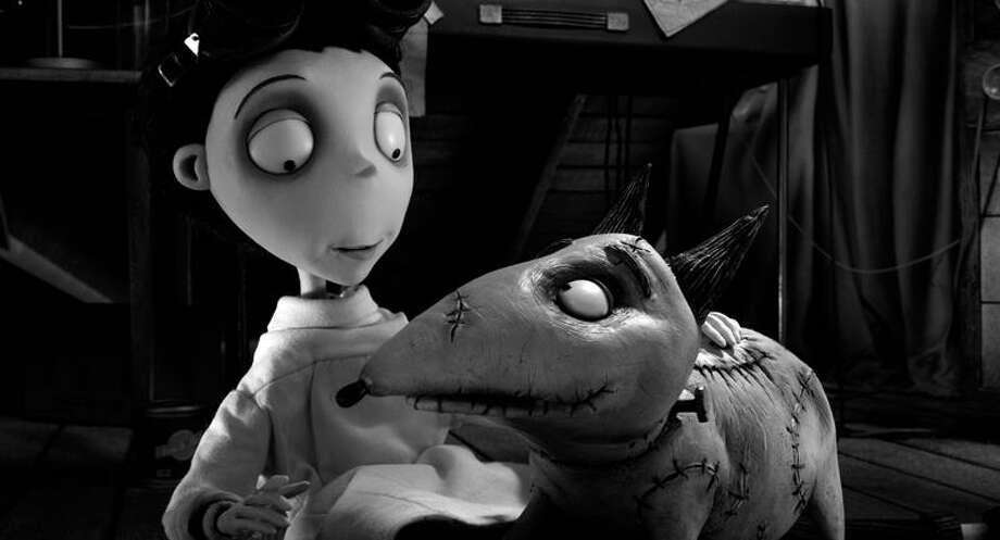 "Disney photo: Victor Frankenstein, voiced by Charlie Tahan, and his beloved Sparky in ""Frankenweenie."" Photo: AP / Disney Enterprises2012"
