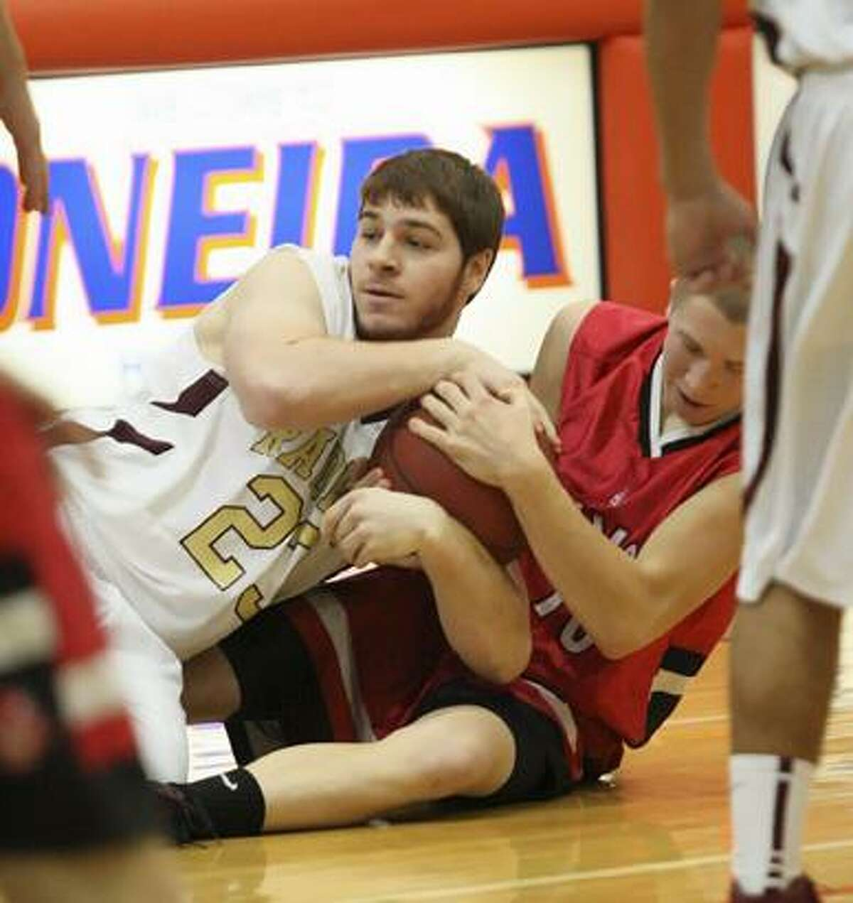 Dispatch Staff Photo by JOHN HAEGER twitter.com/oneidaphotoVVS Christian Tiffin (30) and Canastota's Matt Russitano (23) tie up for the loose ball on the floor in the second half of the 13th Annual Alliance Bank Oneida Sports Boosters Basketball Shootout consolation game on Saturday, Dec. 1, 2012 in Oneida.