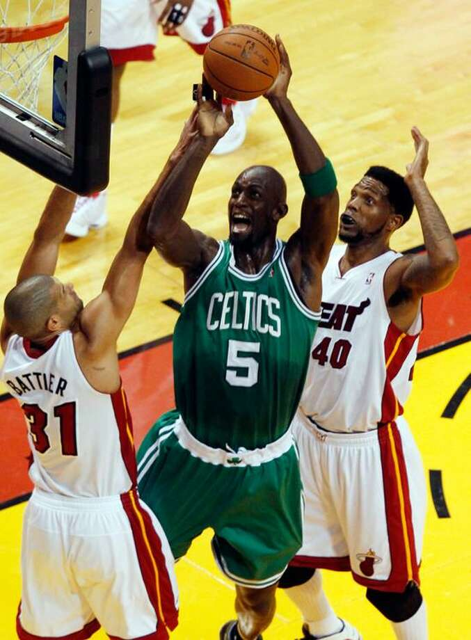 Boston Celtics' Kevin Garnett (5) drives to the basket over Miami Heat's Shane Battier and Udonis Haslem (40) during the first half of Game 5 in their NBA basketball Eastern Conference finals playoffs series, Tuesday, June 5, 2012, in Miami. (AP Photo/Wilfredo Lee) Photo: AP / AP