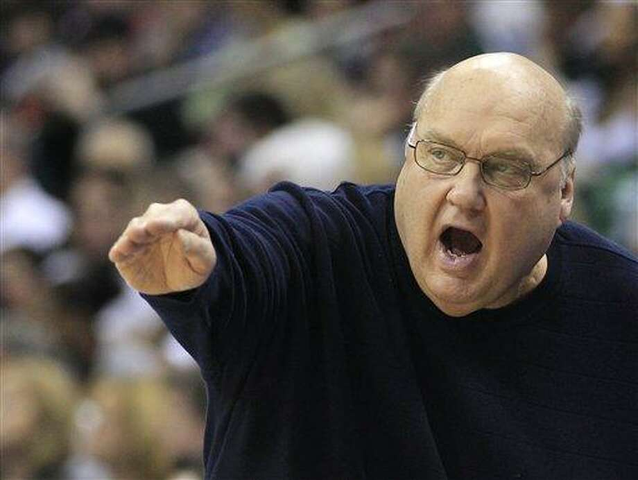 FILE - In this March 18, 2012, file phot, Saint Louis head coach Rick Majerus reacts during the first half of an NCAA men's college basketball tournament third-round game against Michigan State in Columbus, Ohio. Majerus will not return to the team because of a serious heart condition. Majerus has been undergoing evaluation and treatment in California for ongoing heart trouble. (AP Photo/Tony Dejak, File) Photo: ASSOCIATED PRESS / A2012