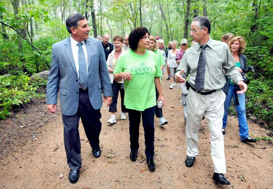 Left to right, state Sen. Len Fasano, Barbara Brow, East Haven chairman of the Shoreline Greenway Trail Advisory Committee, and East Haven Mayor Joseph Maturo Jr., walk to the ribbon cutting for a new section of the Shoreline Greenway Trail near D.C. Moore School in East Haven. Photo by Arnold Gold/New Haven Register