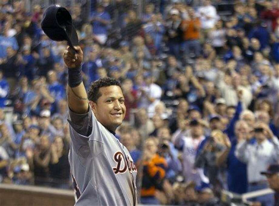 Detroit Tigers' Miguel Cabrera waves to the crowd after being replaced during the fourth inning of a baseball game against the Kansas City Royals at Kauffman Stadium in Kansas City, Mo., Wednesday, Oct. 3, 2012. Cabrera achieved baseball's first Triple Crown since 1967 by leading the league with a .330 average, 44 home runs and 139 RBIs in the regular season. (AP Photo/Orlin Wagner) Photo: ASSOCIATED PRESS / AP2012