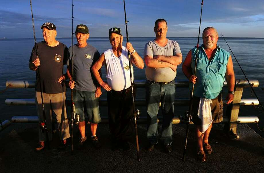 Left to right, fishermen Fred Schroeder, Barry Andes, Al Terr, Michael Salvestrini and Joe Capecea of West Haven are photographed on the fishing pier at Savin Rock in West Haven on 7/31/2012. (Photo by Arnold Gold/New Haven Register)