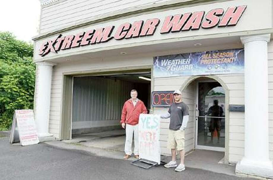 Dispatch Staff Photo by CAITLIN TRAYNOR Extreme Car Wash owners Bob and Tom Moher stand outside the business in Oneida on Monday.