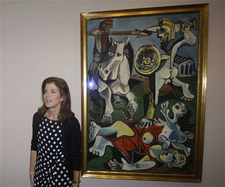 """Caroline Kennedy, president of the John F. Kennedy Library Foundation, unveils Pablo Picasso's painting """"Rape of the Sabine Women"""" at the JFK Library and Museum in Boston, Thursday, Oct. 4. The painting is on loan to the library from the Museum of Fine Arts in commemoration of the upcoming 50th anniversary of the Cuban Missile Crisis, which was Picasso's inspiration for the work. ASSOCIATED PRESS PHOTO Photo: AP / AP"""