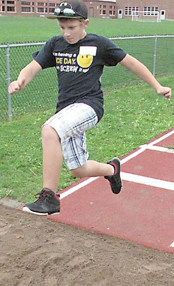 Troy Brown of Canastota competes in the long jump; he leapt 7 feet in the event.