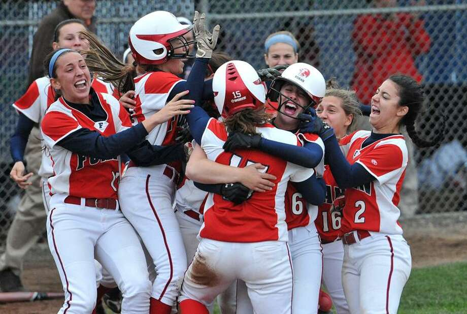 New Haven--Foran High School celebrates their 2-1 win over Brookfield during the Connecticut Class L Semi-final softball championships. Peter Casolino/New Haven Register  06/04/2012
