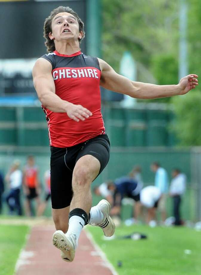 CIAC State Open Track meet, Willowbrook Park, New Britain. Long jump: Cheshire's Jake Scinto competing; he came in first. Mara Lavitt/New Haven Register6/4/12