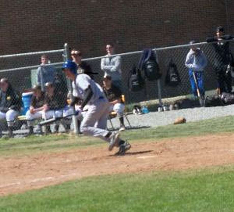 PETER WALLACE/Register Citizen Mills junior Kyle Eisenmann was 3-for-4 with a home run and 2 RBI in the Spartans' 9-0 win at Thomaston Saturday morning.