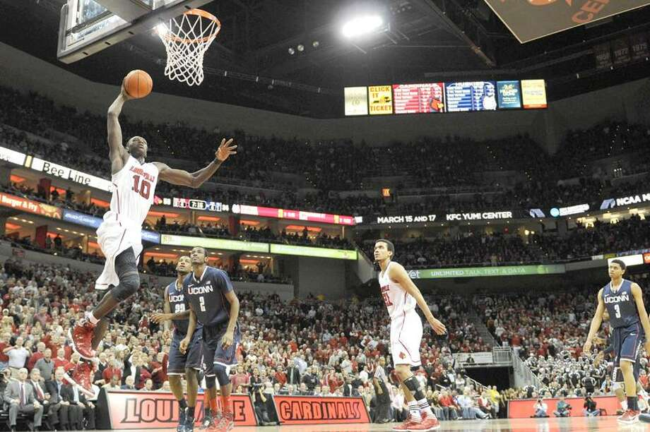 Louisville center Gorgui Dieng (10) drives to the basket for a dunk against UConn during the second half at the KFC Yum! Center. Louisville defeated Connecticut 80-59.  Credit: Jamie Rhodes-US PRESSWIRE via Reuters Photo: US PRESSWIRE / Jamie Rhodes
