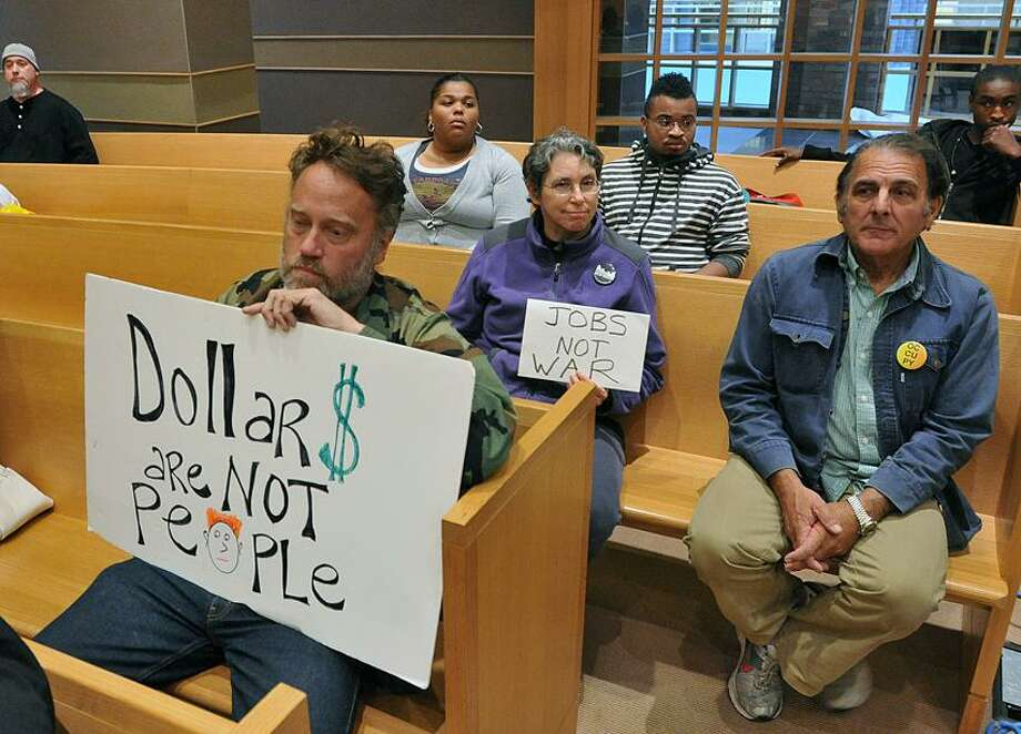 Protesters, including Ray Neal, front, attended the New Haven Board of Aldermen meeting at City Hall early Monday evening. Peter Casolino/New Haven Register