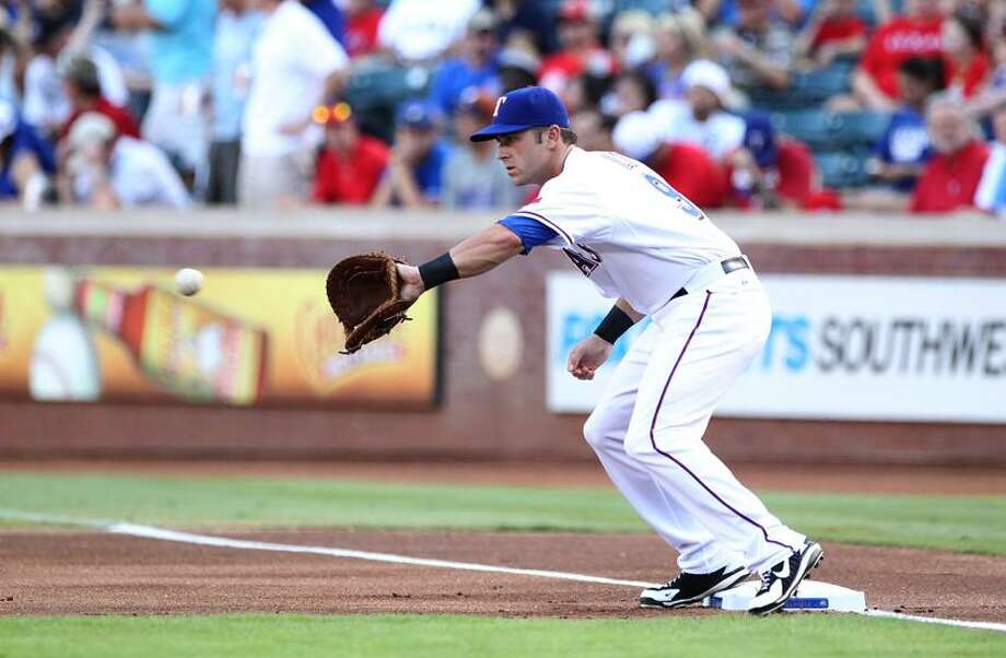 Branford's Mike Olt warms up prior to the Texas Rangers game against the Los Angeles Angels Thursday. It was Olt's first game in the majors. (Matthew Emmons-US PRESSWIRE) Photo: US PRESSWIRE / Matthew Emmons-US PRESSWIRE