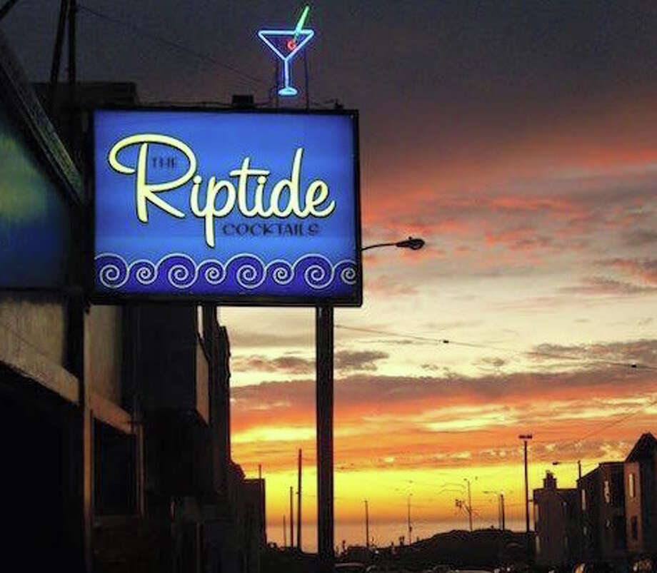 """The RiptideThis self-described """"honky-tonk bar"""" with a fireplace and caribou head that feels like a rock musician's lodge has been warming up Ocean Beach surfers and Outer Sunset drinkers since 1941, and it rose from the ashes in August 2016 after being closed because of a devastating fire in August 2015. The blaze destroyed much of the beloved historical décor, including Barbary Coast antiques and the head of Bou the Caribou. But owners David Quinby and Les James have recreated much of that with new collectibles and antiques, plus more taxidermy.What makes The Riptide special: Along with the fireplace and the caribou head, there's a busy calendar of events that's finally coming back two years after the fire. They include live bands and DJs on the weekend, karaoke on Tuesdays, and White Trash Fridays with happy-hour barbecue.What to drink at The Riptide: Consider the Lemmy, or Jack and Coke, which was named after the late Motörhead musician of the same name after he visited the bar. That's the only drink he was known to have. Photo: Courtesy Of The Riptide"""