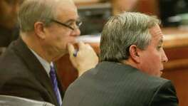 Texas Attorney General Ken Paxton (right) is shown with attorney Phil Hilder during a hearing Thursday in the Harris County Criminal 177th District Court of Judge Robert Johnson. The judge ruled that jury selection will begin Dec. 1 and testimony will start Dec. 11 for the count of failing to register as an investment adviser with the state.