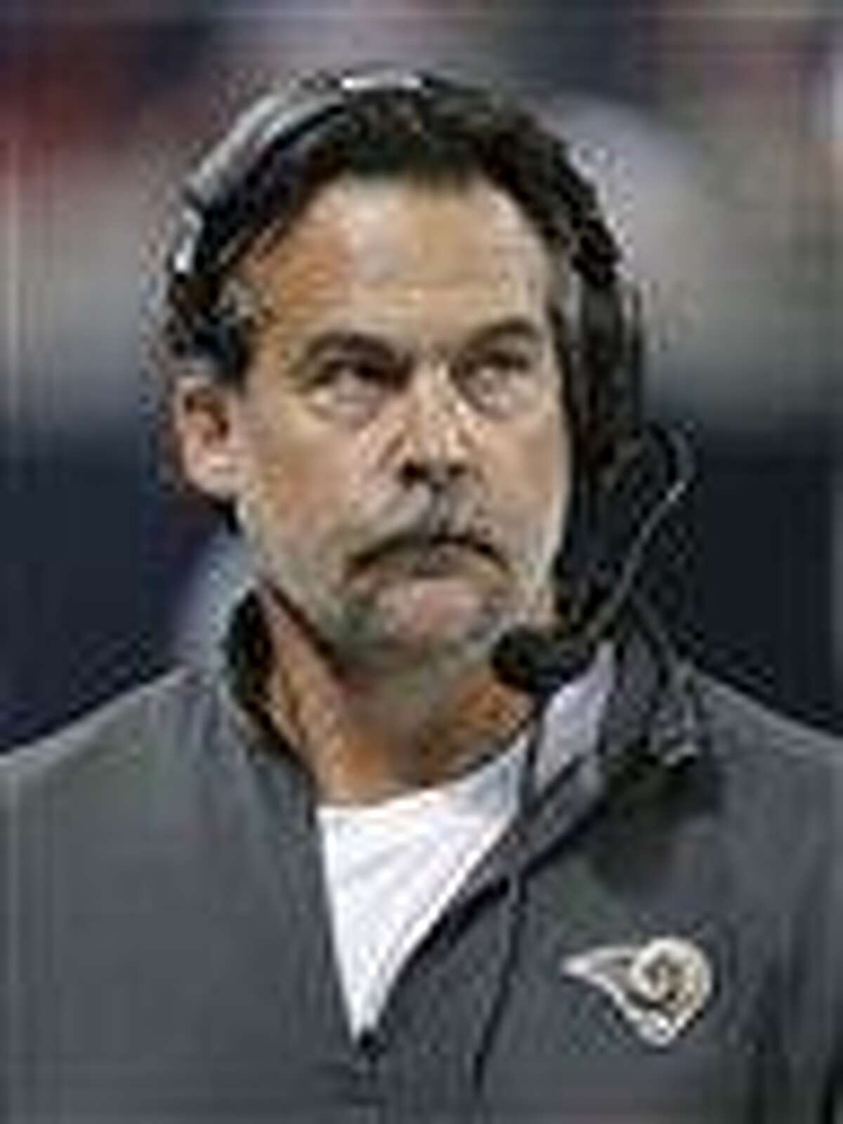 St. Louis Rams coach Jeff Fisher takes a look at the scoreboard during the second half of an NFL football game against the Seattle Seahawks Sunday. Note the mustache. AP Photo