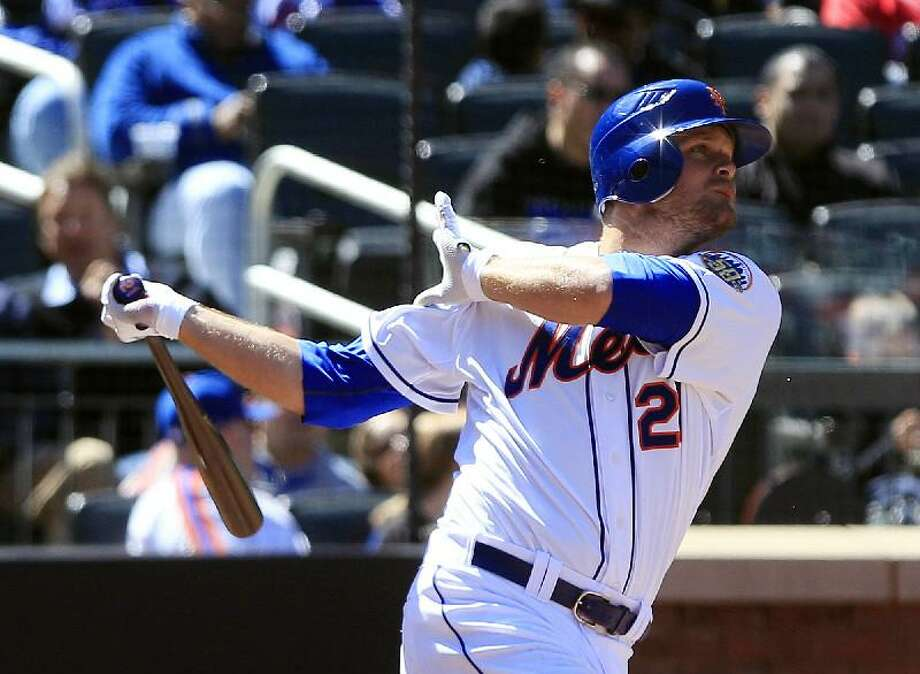 ASSOCIATED PRESS New York Mets right fielder Lucas Duda follows though on a home run during the fourth inning of Saturday's game against the Atlanta Braves in New York. The Mets won 4-2.