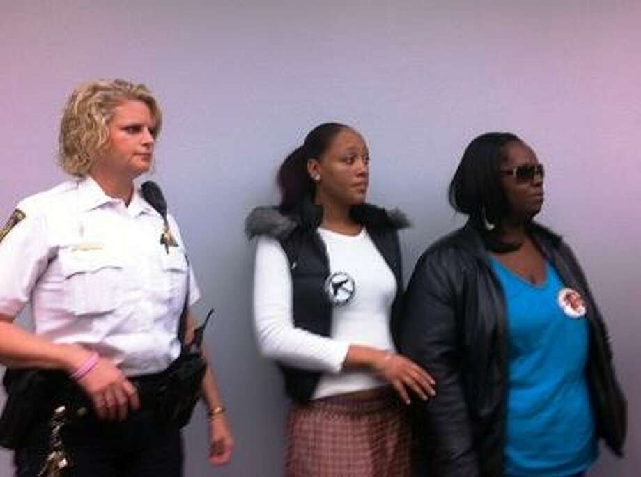 The victim's family stands with police at press conference.