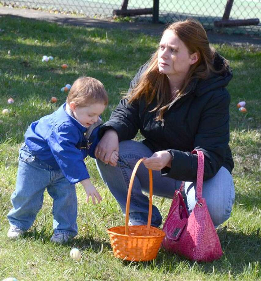 Dispatch Staff Photo by KURT WANFRIEDA boy hunts eggs at the Easter egg hunt Saturday in Allen Park in Oneida.