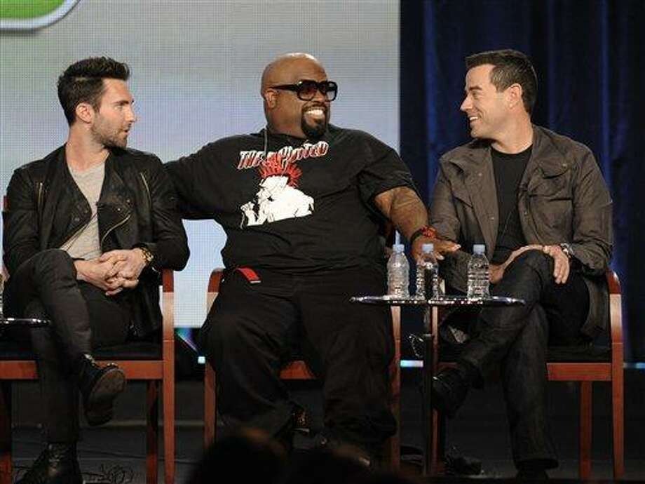"""Singer Adam Levine, left, singer Cee Lo Green, center, and television personality Carson Daly speak during the panel discussion for the reality series """"The Voice"""" at the Television Critics Association Winter Press Tour for NBC Universal in Pasadena, Calif., on Friday, Jan. 6, 2012. (AP Photo/Dan Steinberg) Photo: AP / AP"""