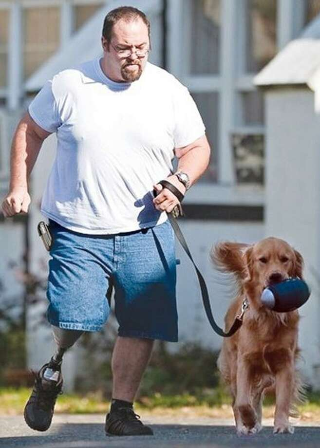 Phil Bauer is a veteran of the Iraq war. After he was seriously injured in Iraq, he returned home and suffered from post-traumatic stress disorder. He came to Project HEAL, a program for wounded warriors and part of the ECAD program. Bauer is running with his service dog, Reese.