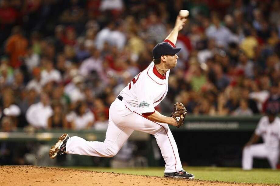 Boston relief pitcher and former Yalie Craig Breslow pitches against the Detroit Tigers Wednesday night at Fenway Park. (Mark L. Baer-US PRESSWIRE) Photo: US PRESSWIRE / Mark L. Baer