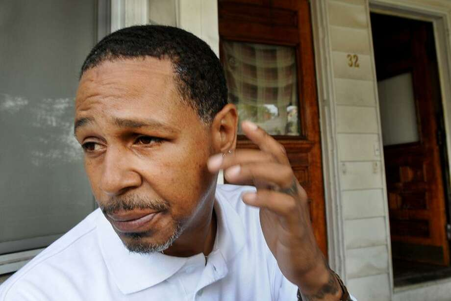 Todd Williams of New Haven who was assaulted recently, hit over the head with a bottle by a man swearing racial epithets at Williams and his family, while Williams was out to dinner with his family in Hamden. Photo by Peter Hvizdak / New Haven Register Photo: New Haven Register / ©Peter Hvizdak /  New Haven Register