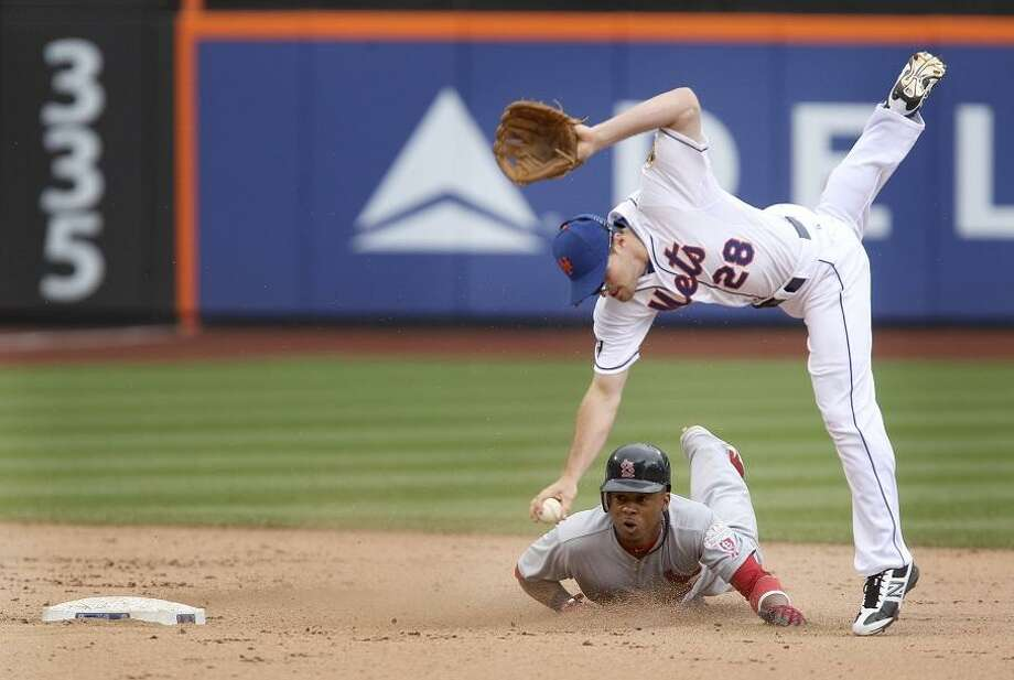 New York Mets second baseman Daniel Murphy, top, tags out St. Louis Cardinals' Adron Chambers during the seventh inning of the baseball game Monday, June 4, 2012, at Citi Field in New York.  (AP Photo/Seth Wenig). Photo: ASSOCIATED PRESS / AP2012