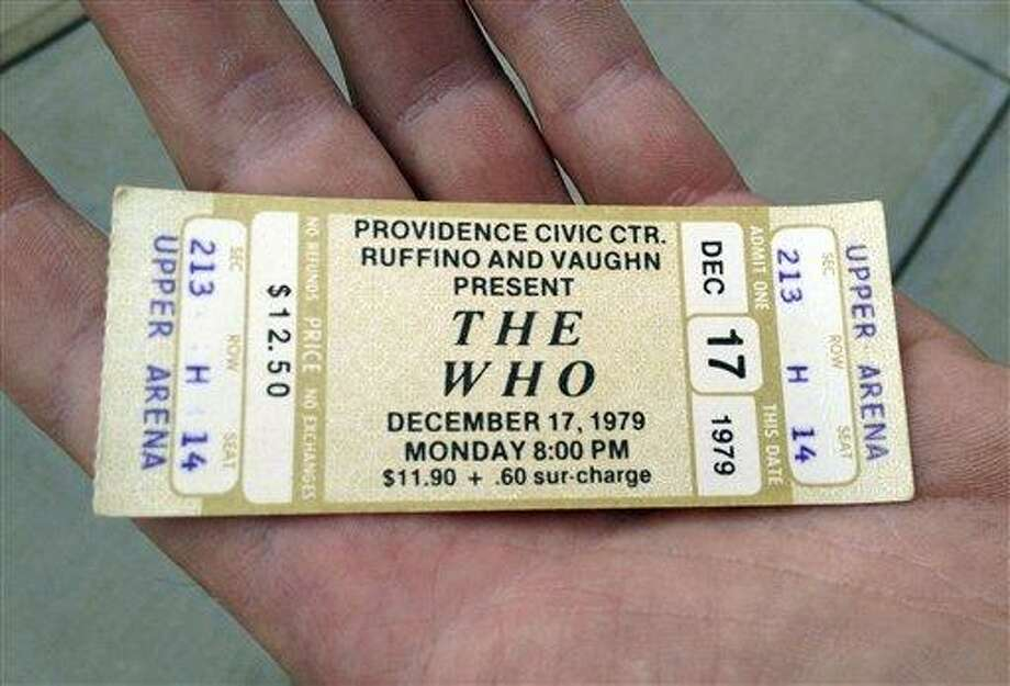 Emery Lucier, 50, of Milford, Mass., holds a ticket for a canceled 1979 concert by The Who at the Dunkin Donuts Center in Providence, R.I., Tuesday. Lucier was among fans who redeemed tickets from a canceled 1979 show, for The Who's Quadrophenia show set to play there in February 2013. Their 1979 concert was canceled due to safety concerns after 11 people died in a stampede before a show in Ohio. Associated Press Photo: ASSOCIATED PRESS / AP2012