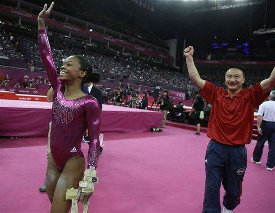 U.S. gymnast Gabrielle Douglas waves to the audience after her final and deciding performance on the floor, followed by coach Liang Chow during the artistic gymnastics women's individual all-around competition at the 2012 Summer Olympics, Thursday, Aug. 2, 2012, in London.  (AP Photo/Julie Jacobson) Photo: AP / AP